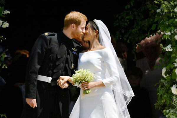 O príncipe Harry de Gales, e sua esposa, Meghan Markle, duquesa de Sussex